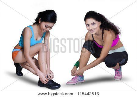 Two Sporty Woman Preparing To Run