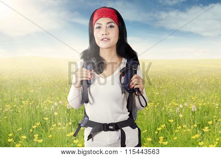 Woman Hiking On The Meadow