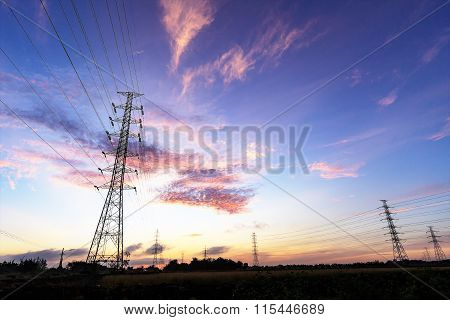 Silhouette Electrical Power Tower With Sunrise
