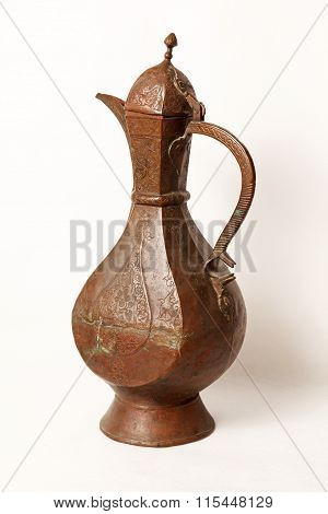 Old wine jug on a white background