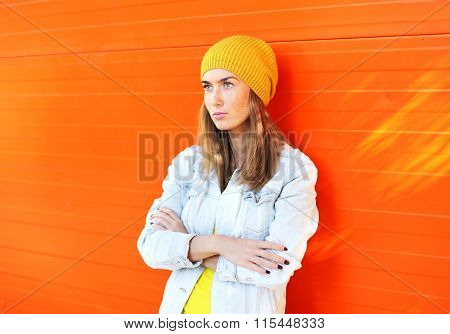 Fashion Pretty Woman Wearing A Colorful Clothes Over Orange Background