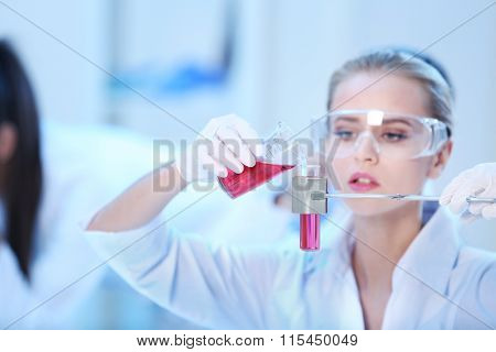 Young female medical technician working in laboratory