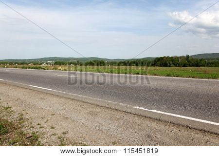 The road stretches into the distance