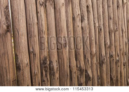 Closeup Old Wooden Fence Of Logs In Form Of Palisade