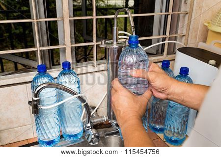 Person Recycle Empty Plastic Bottle From Filtered Tap Water