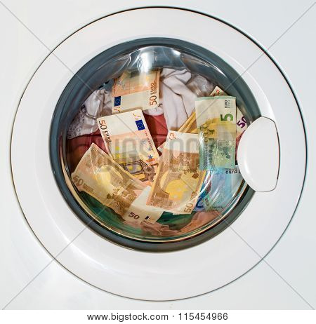 Lots of euros in washing machine. Dirty money concept.