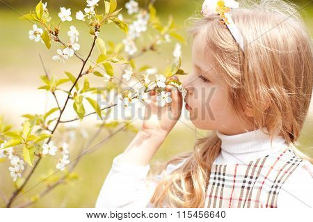 Child with flowers outdoors