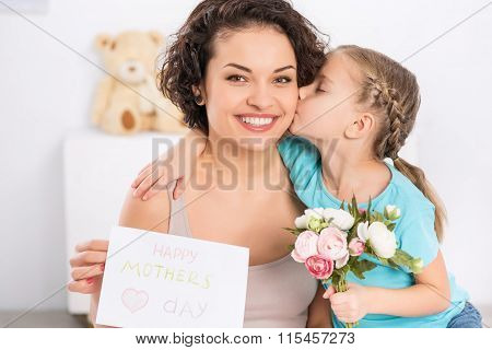 Daughter hugs and greets her mom.