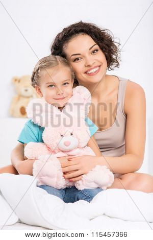 Mom with daughter and her toy.