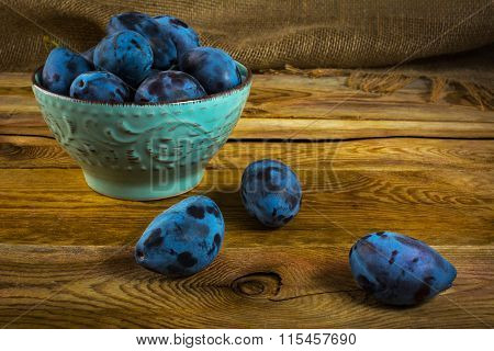 Plum Prunes In A Turquoise Cup
