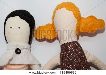 Face And Faceless Doll Together