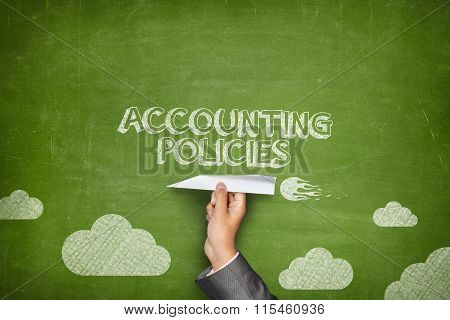 Accounting policies concept on blackboard with paper plane