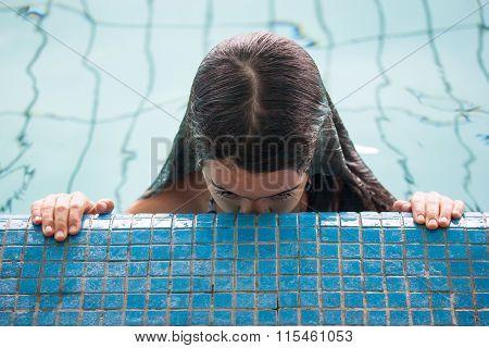 Girl Exiting Swimming Pool