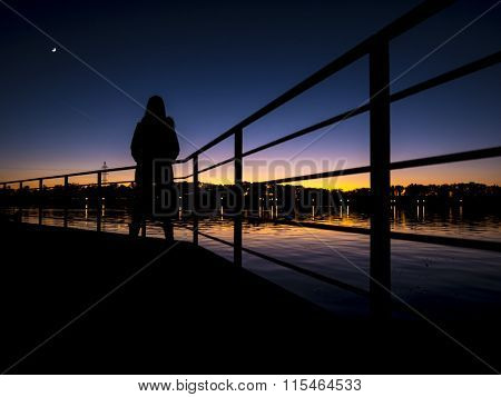 woman backlit / sunset on lake