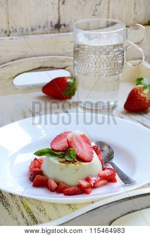 Basil panna cotta with strawberries