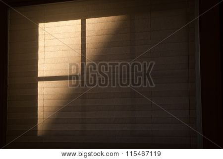 Sun and shadows on blind