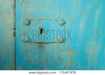 keyhole on metal doors painted in blue