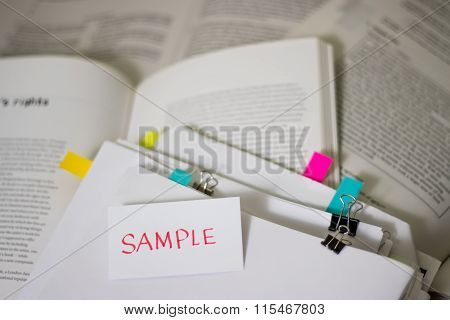 Sample; Stack Of Documents With Large Amount Of Reading Material.