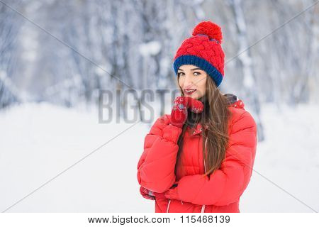 Beautiful Winter Portrait Of Young Woman In The Winter Snowy Scenery. Beautiful Girl In Winter Cloth