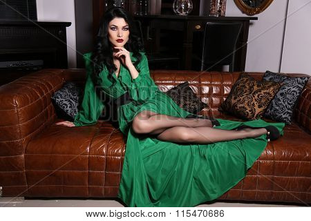 Beautiful Sensual Woman With Dark Hair Wears Elegant Green Dress,