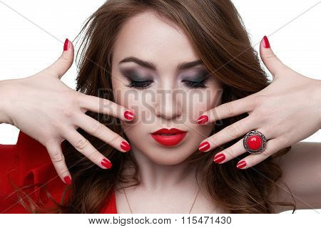 Fashion model with red lipstick and nails. Beauty female face. Perfect skin make up. Red lips  nail