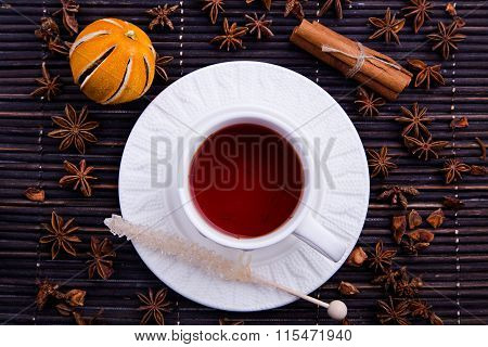 Winter cosy cup with rooibos tea and sugar stick