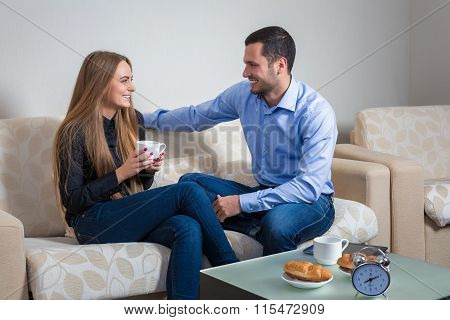 Portrait of lovely young man and woman on the couch