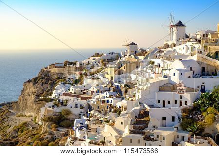 View Of Beautiful Village Of Oia With Whitewashed And Colorful H