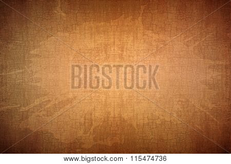 Grungy stained and cracked antique brown paper background texture