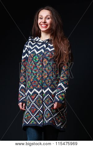 Young Attractive Girl In A Knitted Wool Sweater With A Wide Open Mouth Laughs And Smiles In The Fram