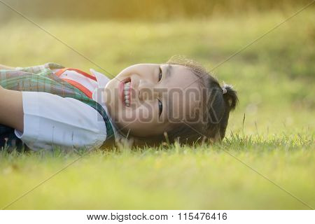 Happy Little Girl  In School Uniformhaving Fun At The School