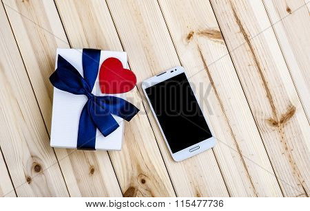 Smart Phone, Gift Box And Heart.
