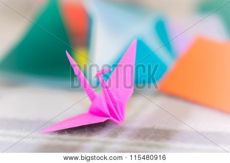 Teaching How To Make Crane From Small Piece Of Origami