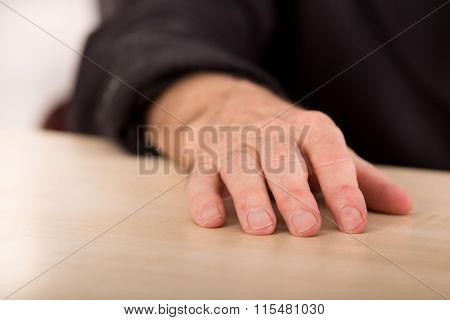 Wrinkled Hand On The Table
