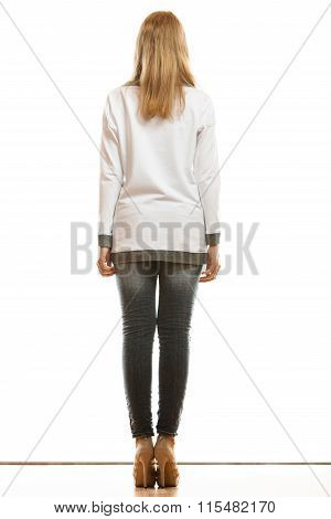 Woman In Denim Pants High Heels Shoes Back View