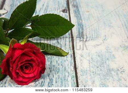 Red Rose On Wooden Background With Vintage Effect