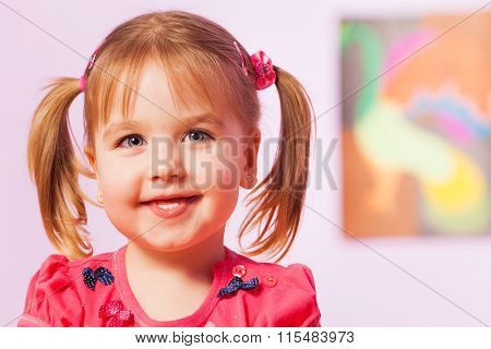 Happy and smiling portrait of girl with ponytails