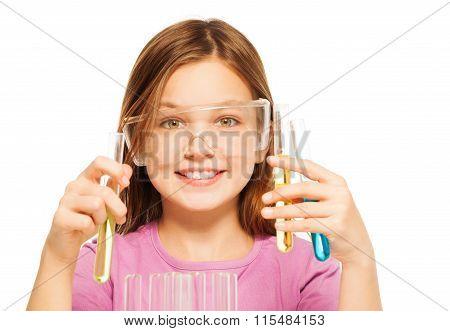 One schoolgirl in safe eyewear studying chemistry