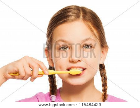 Nice girl with yellow toothbrush