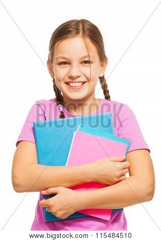 Smiling schoolgirl standing with her textbooks