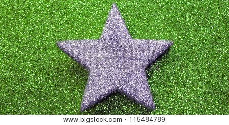 Silver Star On Glitter Material On Green Shiny  Background Blazing Bright
