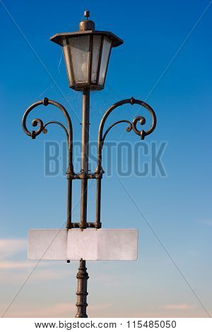 Vintage Lamp Post With Empty Signboard