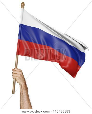 Hand proudly waving the national flag of Russia
