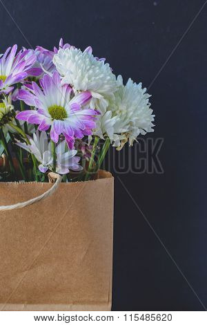 Flowers In Brown Paper Bag With Black Blank Space