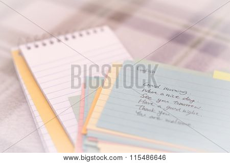 English; Learning New Language Writing Greetings On The Notebook