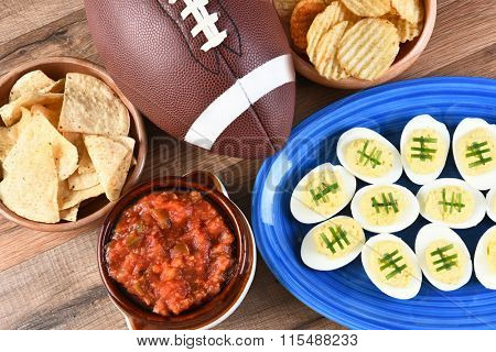 High angle view of snacks for watching a football game. Great for Super Bowl or Playoff themed projects.