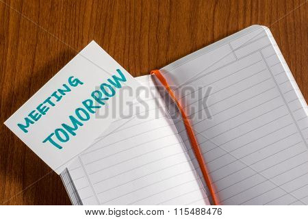 Meeting Tomorrow; White Blank Documents With Small Message Card.