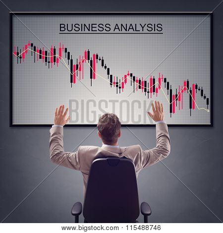 Businessman with trading stock market in economic crisis and line graph showing negative trend decline