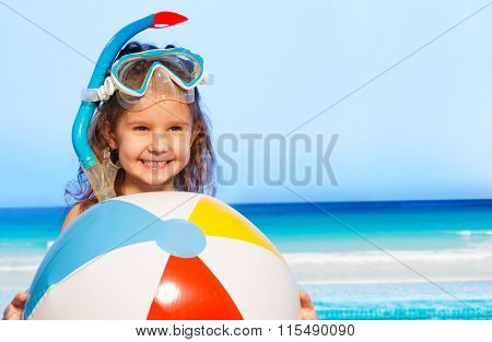 Little smiling girl with big inflatable ball