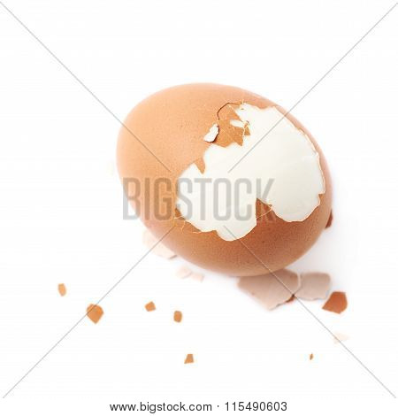 Cracked hard boiled egg isolated